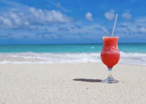Holiday photo white sand blue sea and drink